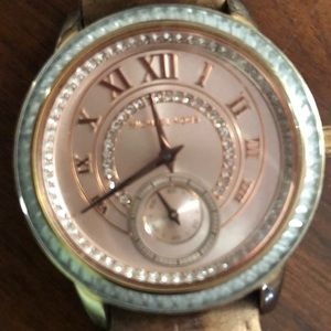 Michael kors rose gold faced watch with brown band